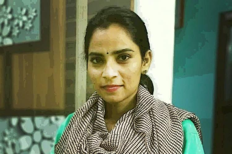Dalit labour activist Nodeep Kaur wearing a grey scarf over a green kurta