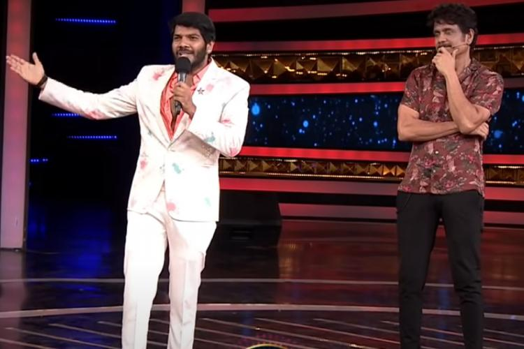 Noel Sen in white suit and Nagarjuna in a brow shirt are seen sharing the BiggBoss stage together