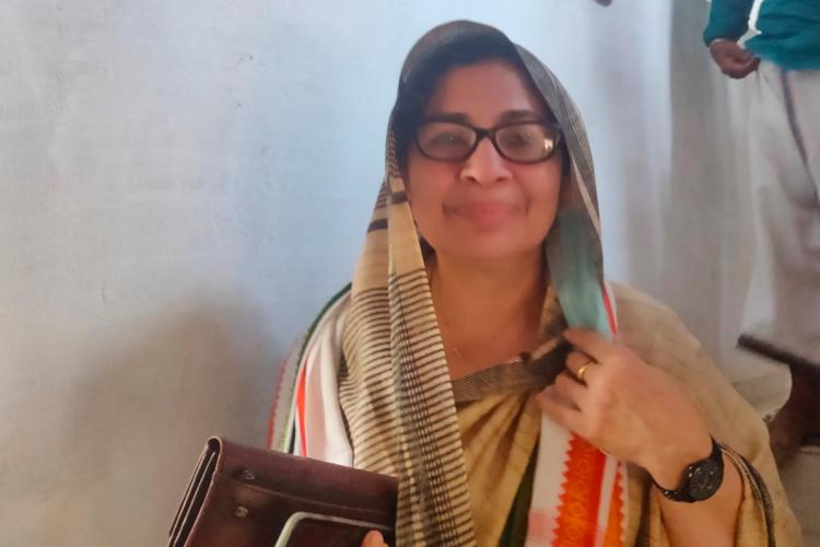 Keralas only woman candidate of IUML Noorbina Rasheed smiling with her head covered with saree