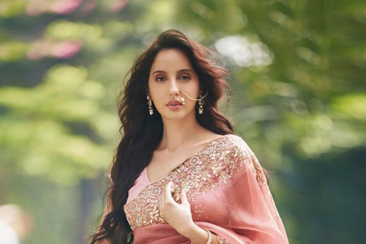Bollywood actor Nora Fatehi wearing a saree