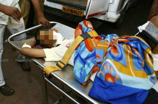 Kerala child torture Mother arrested for brutalizing son
