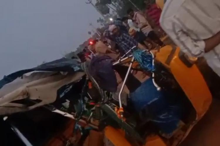 A seven seater auto crashed after colliding with a truck in Nuzvid in Andhra Pradesh