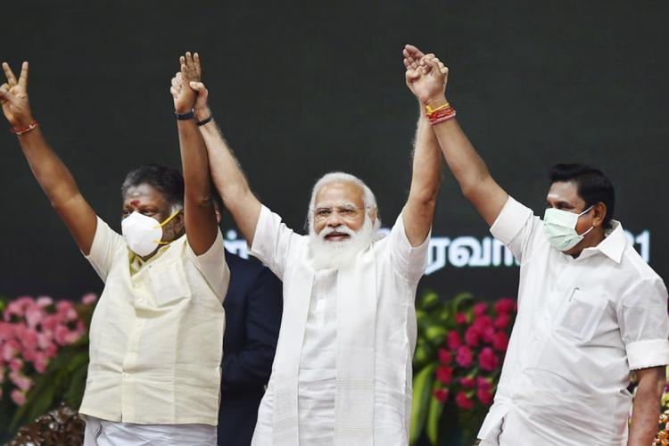 OPS and EPS standing with PM Modi after announcing the alliance for the upcoming elections in Tamil Nadu