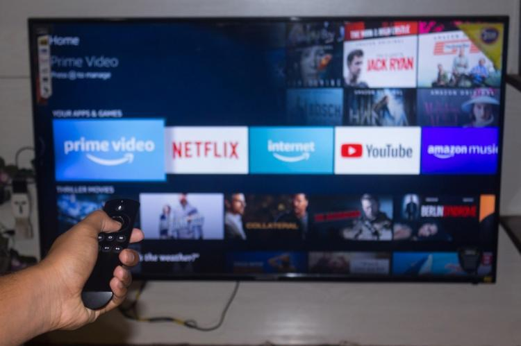 popular OTT platforms appear on a screen
