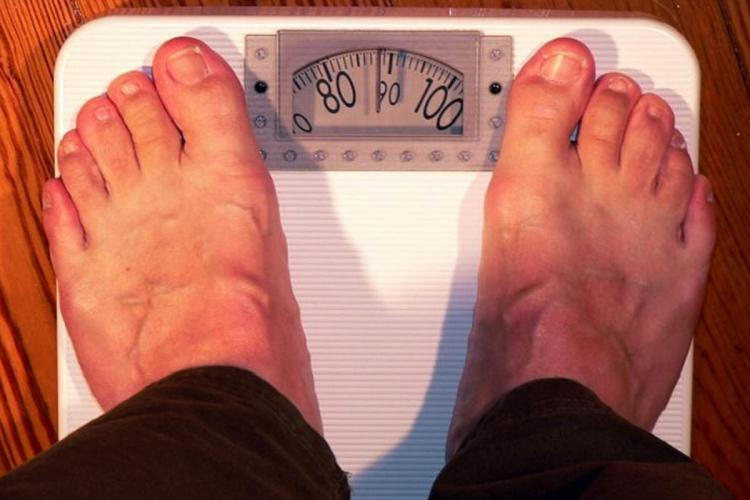 Person standing on weighing machine