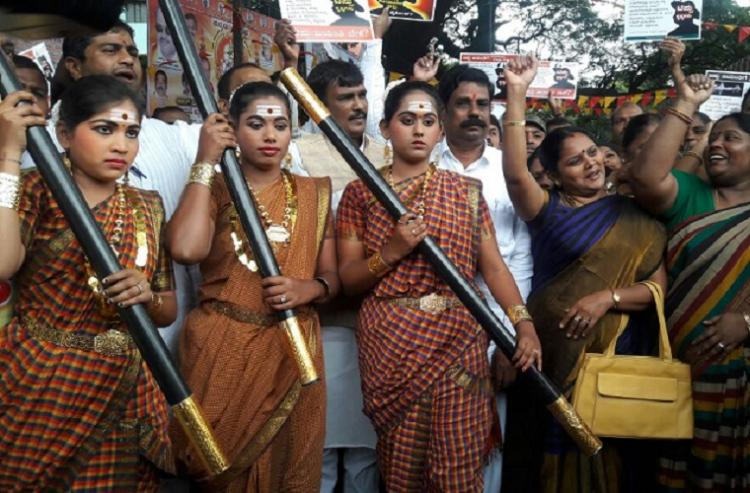 Celebrate local heroine not tyrant Tipu say protesters dressed as Onake Obavva