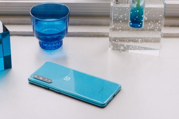 OnePlus Nord in the blue colour variant lying face down on a table