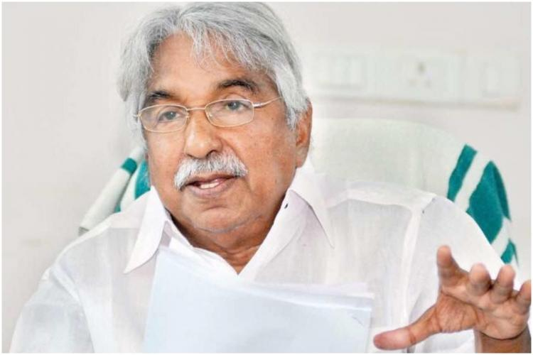 Oommen Chandy in office chair talking