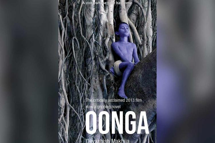 Cover page of childrens novel Oonga which shows a blue coloured adivasi boy