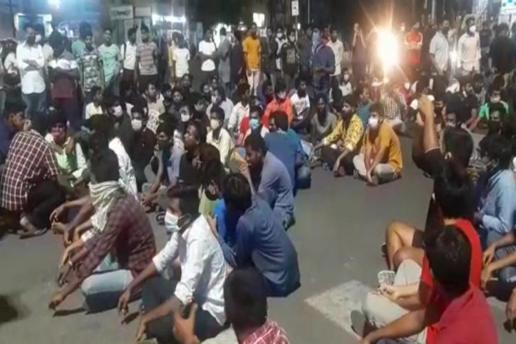 Osmania University students stage sit in protest at Shivam road near university