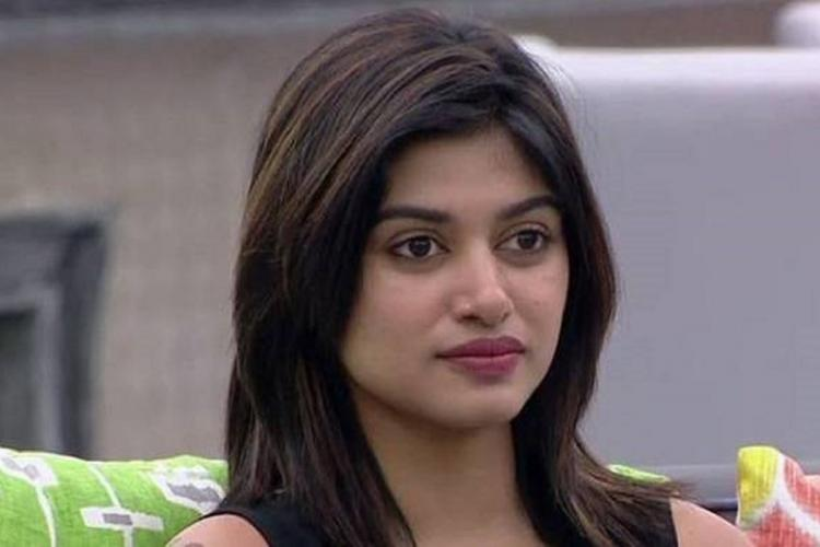 Actor and model Oviyaa in Bigg Boss Tamil close-up shot