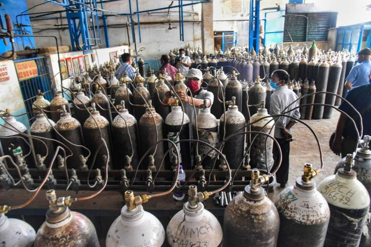 Oxygen cylinders being refilled in Patna to supply it back at hospitals