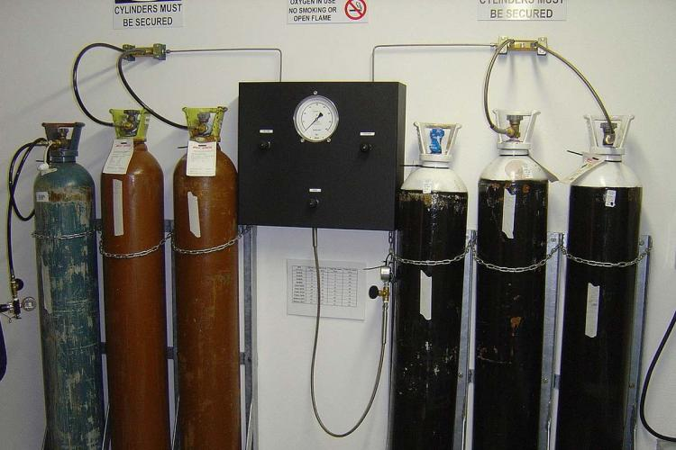 Oxygen cylinders lined up at a hospital