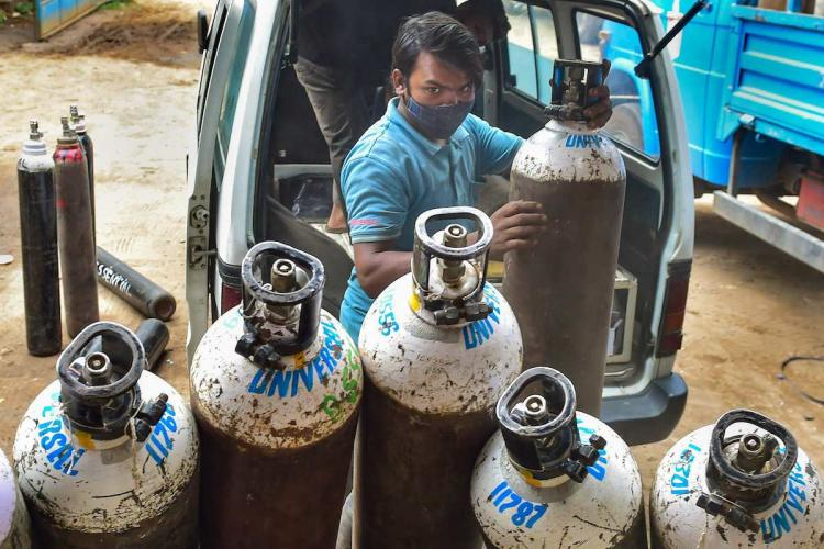 Bengaluru Workers sort medical oxygen cylinders meant for Covid-19 patients before dispatching them to hospitals amid surge in coronavirus cases at BMTC bus stand in Bengaluru