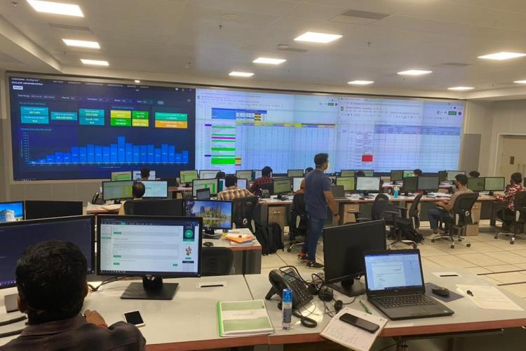Inside the control room in Ernakulam with screens displaying COVID-19 data in district