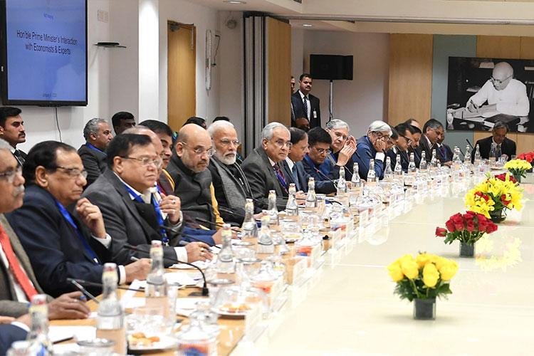 PM Modi meets economists to discuss state of economy and steps to revive growth