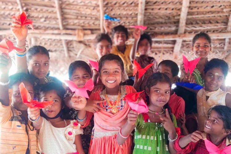 Children smiling and posing at an art workshop in Thanjavur conducted by NGO POPE