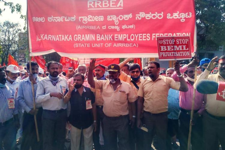 PSU workers protesting holding red banner