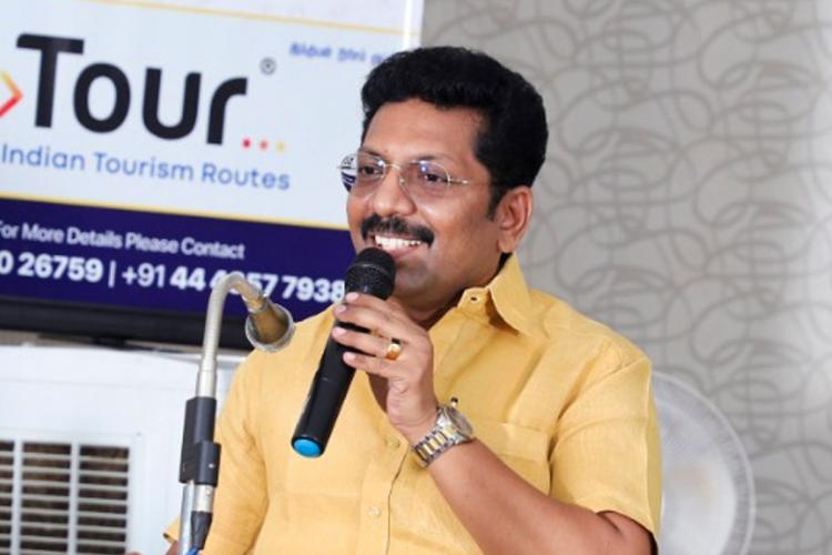 DMK MLA Dr P Saravanan addresses with a mic