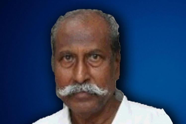 Tamil Nadu former minister PV Damodaran against a Blue background