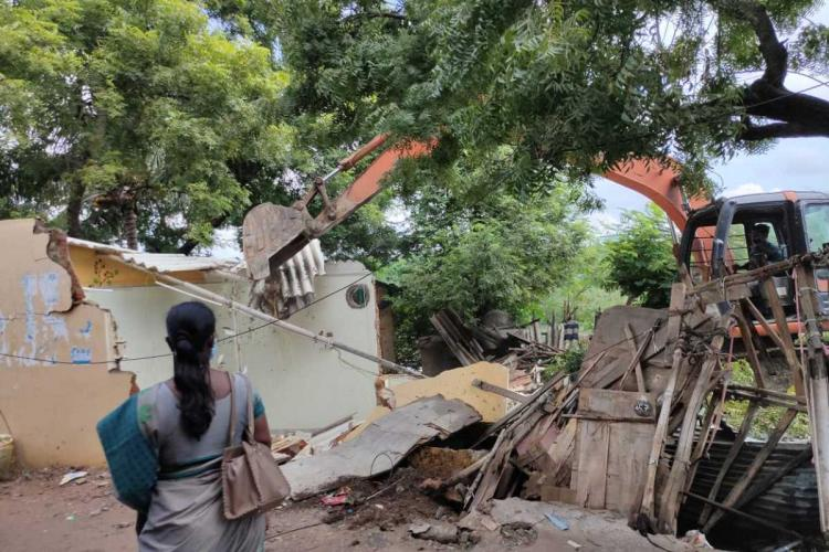 A house being demolished in Padikuppam area of Mogappair