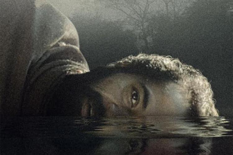 Paka movie poster showing a man with his head half submerged in water