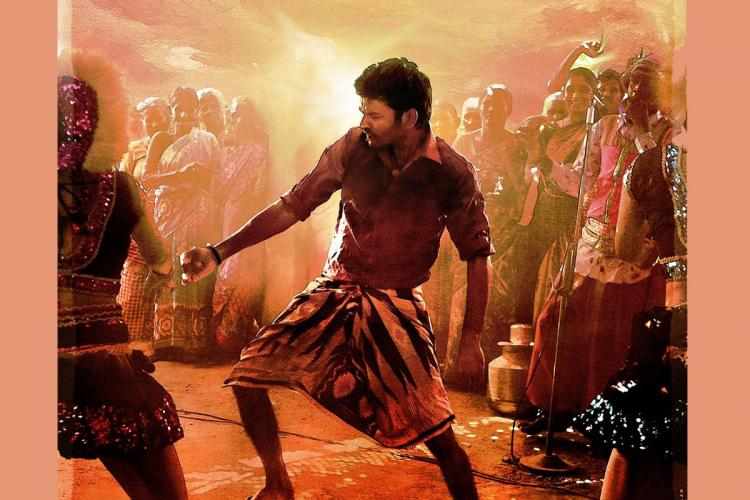 Dhanush is seen dancing alongside other villagers in the graphic art poster of the song Pandarathi Puranam from Karnan