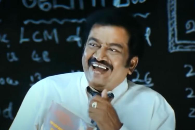 Actor Pandu screenshot standing in front of a black board