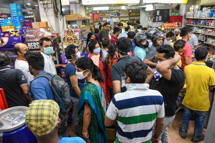 People outside a shop panic buying during Covid-19 induced lockdown fearing shortage of essential commodities
