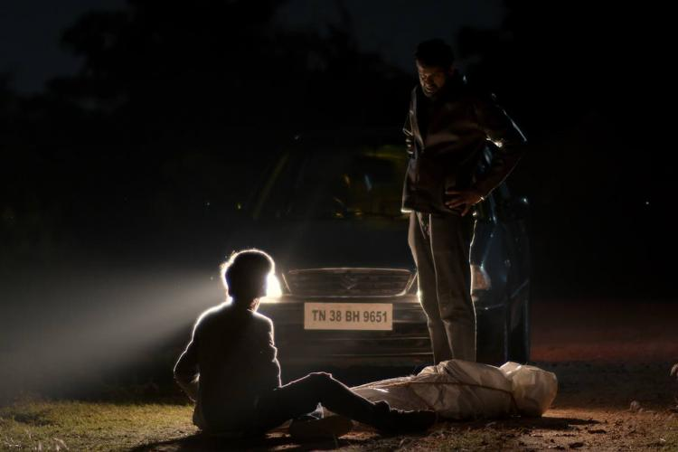 A shot from the indie Tamil film Parallel Lines lit only by the headlights of a car