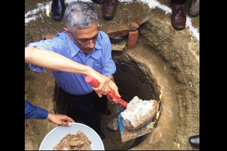 Leading by example Swachh Bharat Mission secretary cleans toilet pit in Telangana village