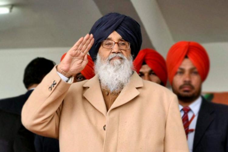Akali stalwart and former Punjab Chief Minister Parkash Singh Badal raising his hand to his forehead
