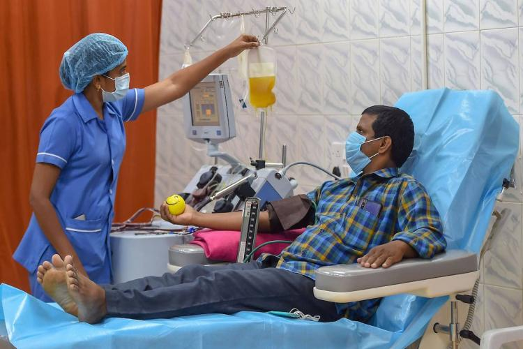 A COVID-19 survivor donates plasma at the Plasma Bank in Rajiv Gandhi Government General Hospital, in Chennai