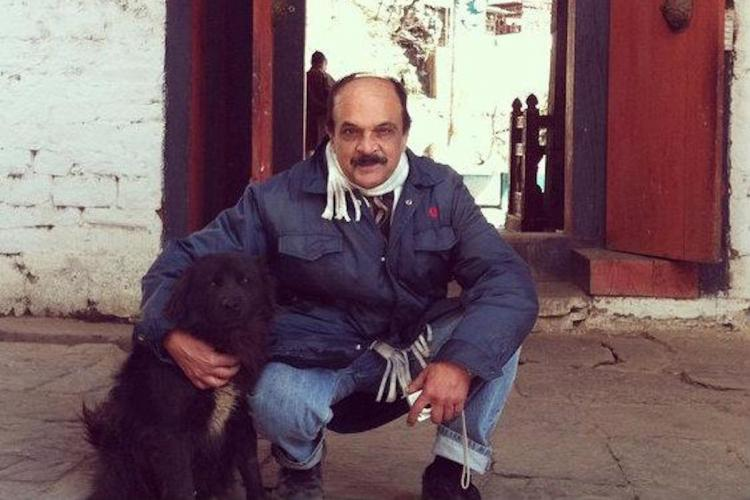 Man posing with a dog