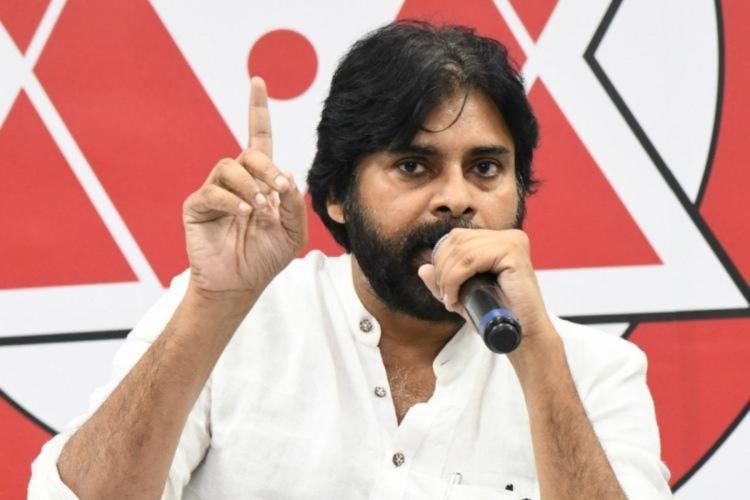 Pawan Kalyan wearing white shirt addressing a gathering with mike