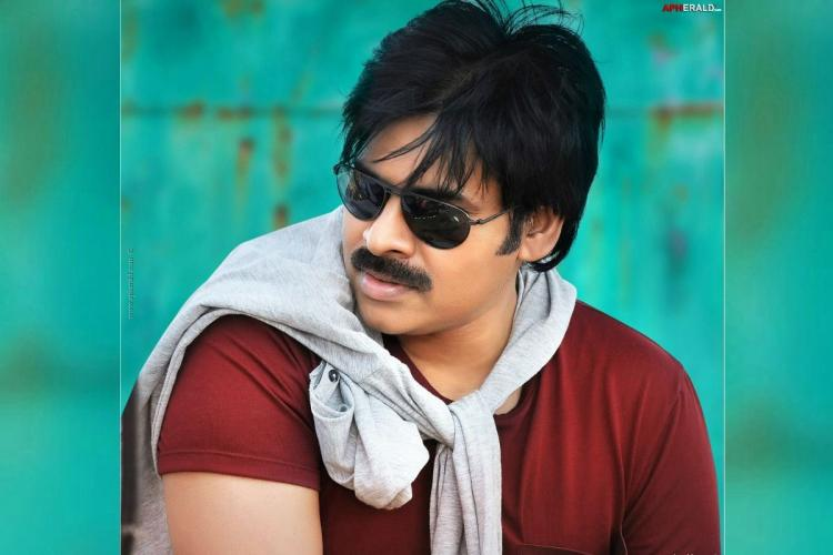 Pawan Kalyan posing for a picture in a brown T shirt and an ash coloured jacket