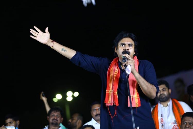 Pawan Kalyan in a public meeting wearing a black shirt and an orange shawl