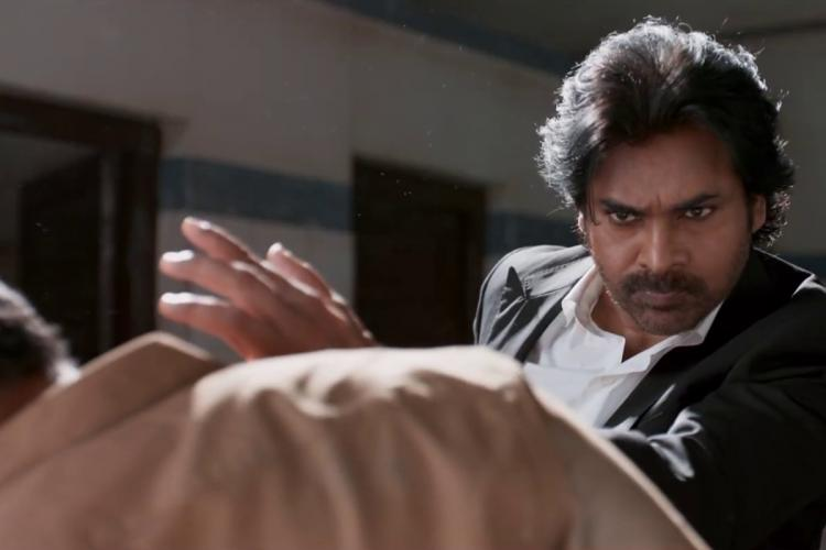 Pawan Kalyan in a black coat and white shirt in the middle of slapping someone