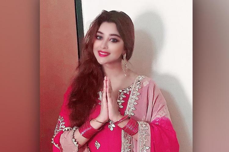 Actor Payal Ghosh folding her hands and looking into the camera