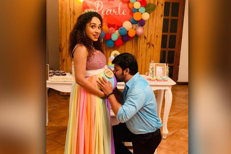 Srinish kissing his wife actor Pearle Maaneys belly at her baby shower