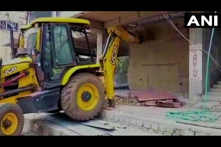Ex-TDP MLAs building partially demolished after Vizag muncipal body serves notice