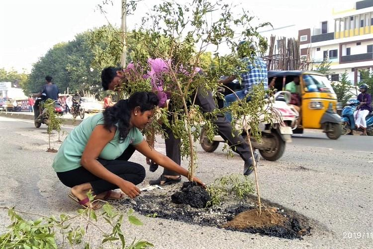Tired of bad roads residents in Hyderabad plant trees in potholes