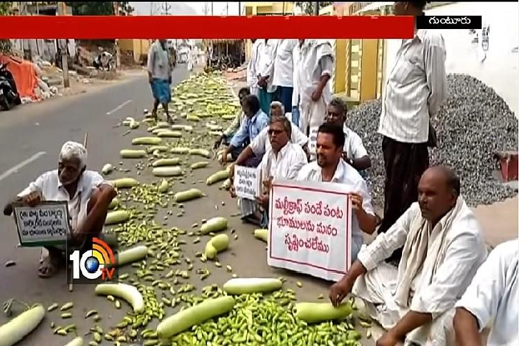 Andhra farmers from Amaravati region dump vegetables on the road protest land acquisition