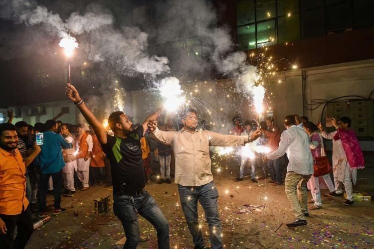 People bursting firecrackers