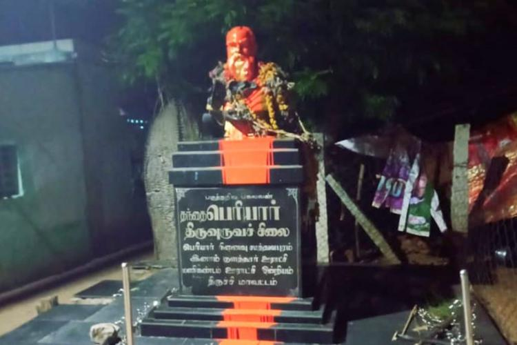 A statue of Periyar in Trichy district doused in saffron paint and garlanded with slippers