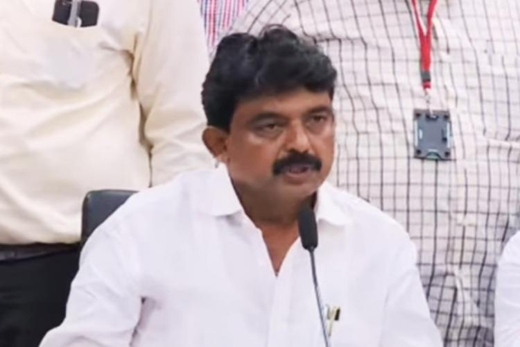 Andhra Transport Minister Perni Venkataramaiah also called Nani in a white shirt addressing media while speaking into a mic