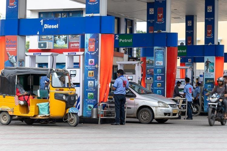 Vehicles lined up at a petrol bunk