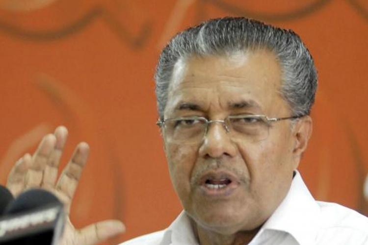 Oommen Chandy in cahoots with BJP-RSS says Pinarayi Vijayan