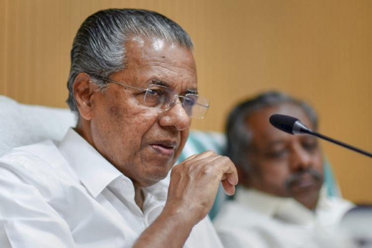 Kerala Chief Minister Designate Pinarayi Vijayan facing a mike while speaking at a meeting