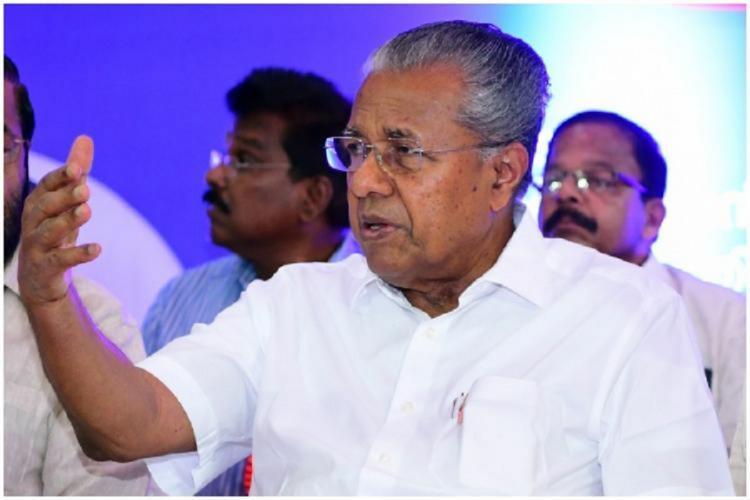 Kerala CM Pinarayi Vijayan sitting at a dais